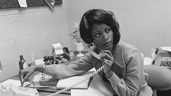A woman answering the phone at work. FPG / Getty Images / Vox.