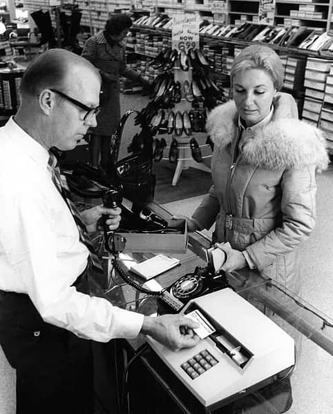 A woman shopping with magnetic stripe technology in the 1970s. IBM