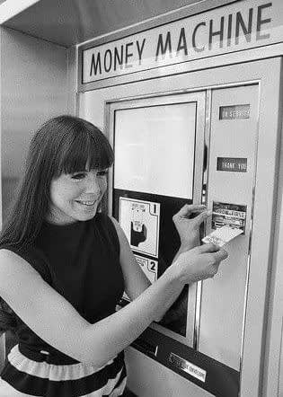 A woman using an ATM for the first time. Pinterest.